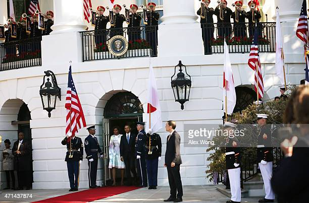 US President Barack Obama and first lady Michelle Obama come out from the residence to welcome Japanese Prime Minister Shinzo Abe and his wife Akie...