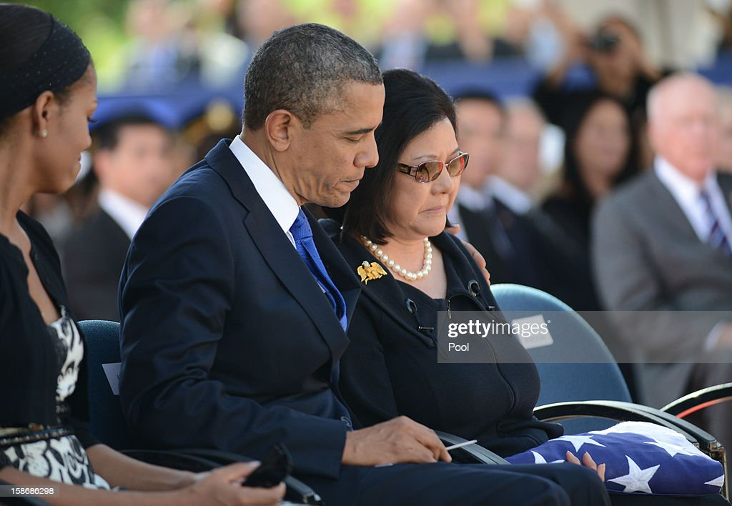 U.S. President <a gi-track='captionPersonalityLinkClicked' href=/galleries/search?phrase=Barack+Obama&family=editorial&specificpeople=203260 ng-click='$event.stopPropagation()'>Barack Obama</a> and first lady <a gi-track='captionPersonalityLinkClicked' href=/galleries/search?phrase=Michelle+Obama&family=editorial&specificpeople=2528864 ng-click='$event.stopPropagation()'>Michelle Obama</a> comfort Senator Inouye's wife, Irene Hirano, during the funeral services for the late Senator Daniel Inouye at the National Memorial Cemetery of the Pacific December 23, 2012 in Honolulu, Hawaii. Senator Inouye was a Medal of Honor recipient and a United States Senator since 1963.