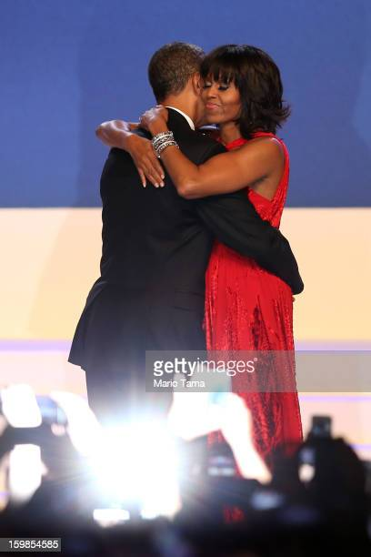 S President Barack Obama and first lady Michelle Obama dance during the Inaugural Ball at the Walter E Washington Convention Center on January 21...