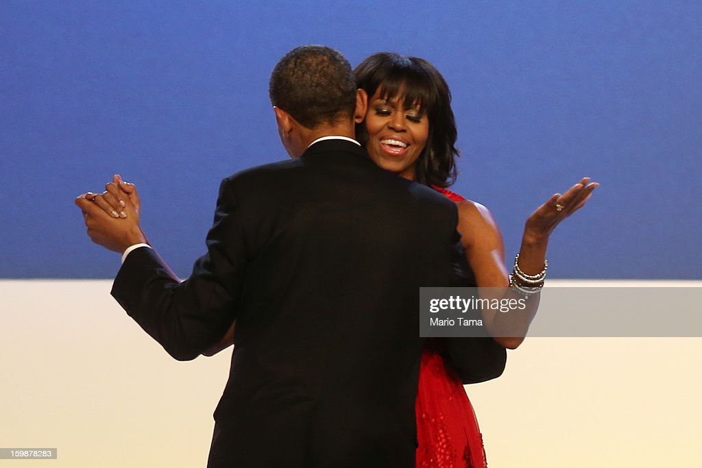 U.S. President Barack Obama and first lady Michelle Obama dance during the Public Inaugural Ball at the Walter E. Washington Convention Center on January 21, 2013 in Washington, DC. President Obama was sworn in for his second term earlier in the day.