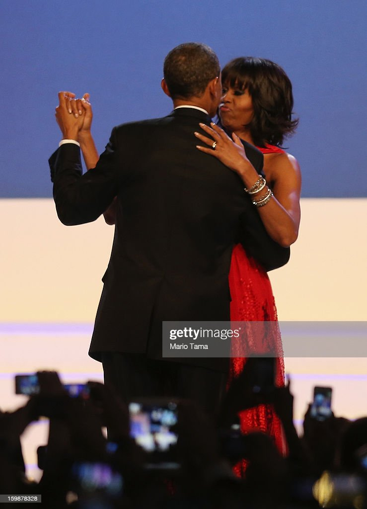 U.S. President <a gi-track='captionPersonalityLinkClicked' href=/galleries/search?phrase=Barack+Obama&family=editorial&specificpeople=203260 ng-click='$event.stopPropagation()'>Barack Obama</a> and first lady <a gi-track='captionPersonalityLinkClicked' href=/galleries/search?phrase=Michelle+Obama&family=editorial&specificpeople=2528864 ng-click='$event.stopPropagation()'>Michelle Obama</a> dance during the Public Inaugural Ball at the Walter E. Washington Convention Center on January 21, 2013 in Washington, DC. President Obama was sworn in for his second term earlier in the day.
