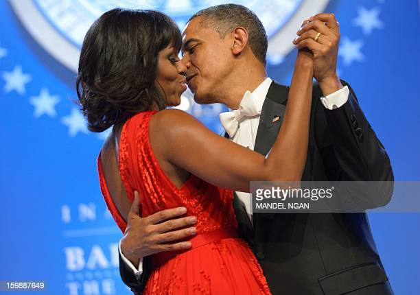 US President Barack Obama and First Lady Michelle Obama dance during the Inaugural Ball at the Walter E Washington Convention Center on January 21...