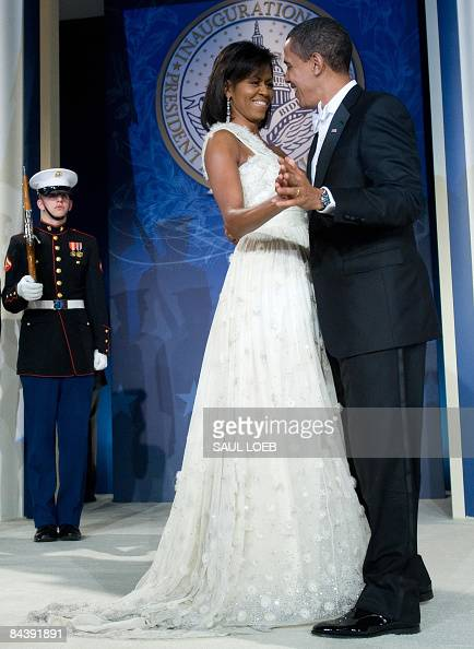 US President Barack Obama and First Lady Michelle Obama dance during the Youth Inaugural Ball at the Hilton Washington in Washington DC January 20...