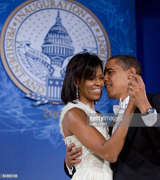 US President Barack Obama and First Lady Michelle Obama dance during the Eastern Regional Inaugural Ball at Union Station in Washington DC early...