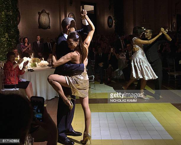 President Barack Obama and First Lady Michelle Obama dance tango with dancers during a state dinner at the Kirchner Cultural Centre in Buenos Aires...