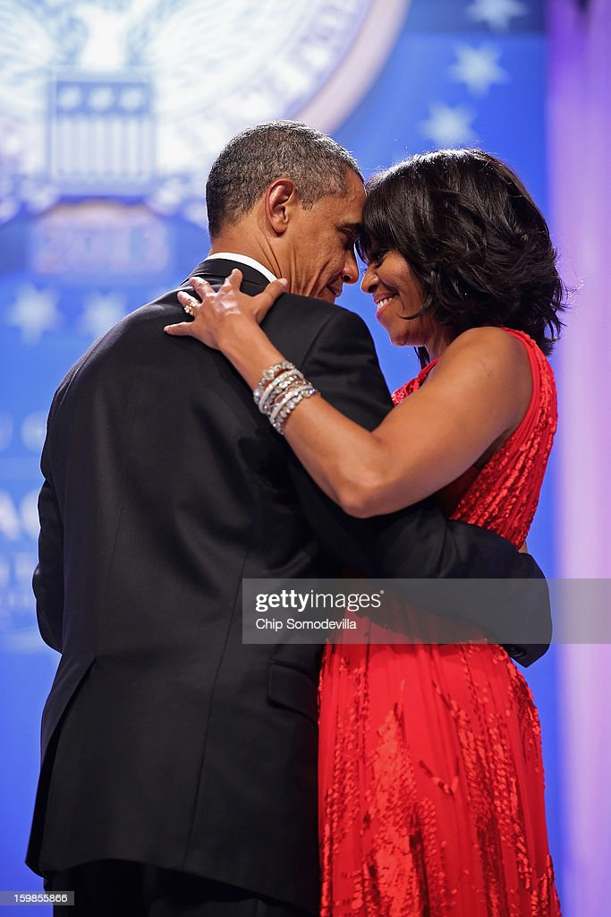 U.S. President Barack Obama and first lady Michelle Obama dance together during the Commander-In-Chief's Ball at the Walter Washington Convention Center January 21, 2013 in Washington, DC. President Obama started his second term by taking the oath of office earlier in the day during a ceremony on the West Front of the U.S. Capitol.