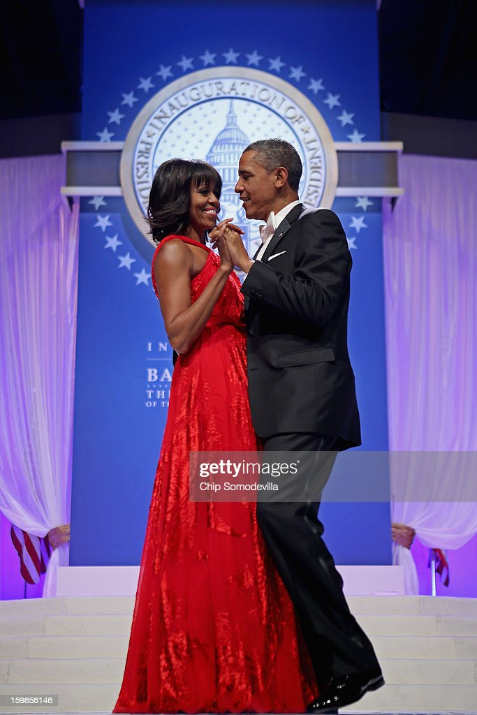 U.S. President <a gi-track='captionPersonalityLinkClicked' href=/galleries/search?phrase=Barack+Obama&family=editorial&specificpeople=203260 ng-click='$event.stopPropagation()'>Barack Obama</a> and first lady <a gi-track='captionPersonalityLinkClicked' href=/galleries/search?phrase=Michelle+Obama&family=editorial&specificpeople=2528864 ng-click='$event.stopPropagation()'>Michelle Obama</a> dance together during the Inaugural Ball at the Walter Washington Convention Center January 21, 2013 in Washington, DC. Obama was sworn-in for his second term of office earlier in the day.