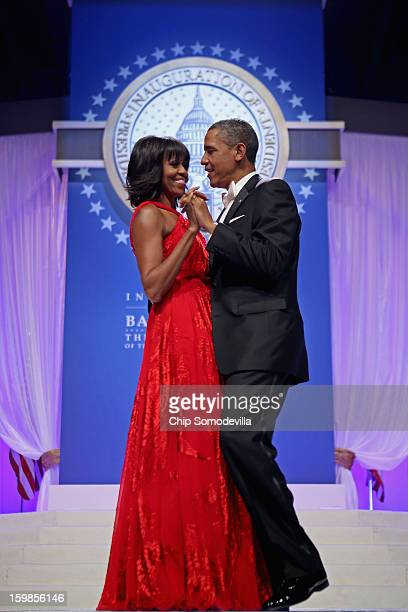 S President Barack Obama and first lady Michelle Obama dance together during the Inaugural Ball at the Walter Washington Convention Center January 21...