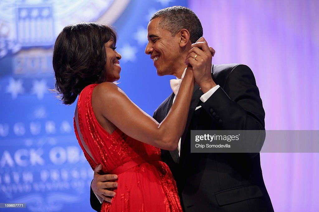 U.S. President Barack Obama and first lady Michelle Obama dance together during the Comander-in-Chief's Inaugural Ball at the Walter Washington Convention Center January 21, 2013 in Washington, DC. Obama was sworn-in for his second term of office earlier in the day.