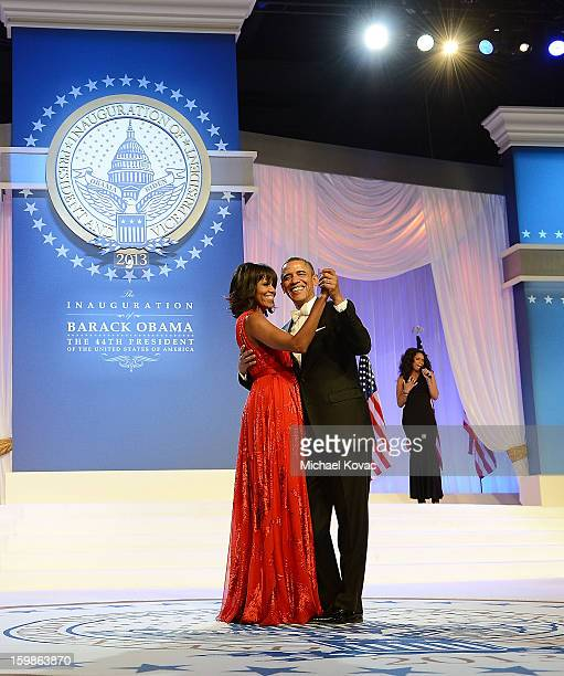 S President Barack Obama and first lady Michelle Obama dance together during The Inaugural Ball as singer Jennifer Hudson performs at the Walter E...