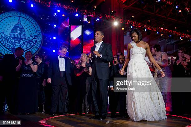 President Barack Obama and first lady Michelle Obama dance together as Beyonce performs at the Neighborhood Inaugural Ballin Washington DC The first...