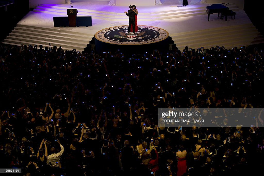 US President Barack Obama and First Lady Michelle Obama dance while attending the Commander and Chief Ball at the Washington Convention Center January 21, 2013 in Washington, DC. Obama and Biden attended Inauguration balls after being ceremonially sworn in for a second term leading the United States earlier today. AFP PHOTO/Brendan SMIALOWSKI
