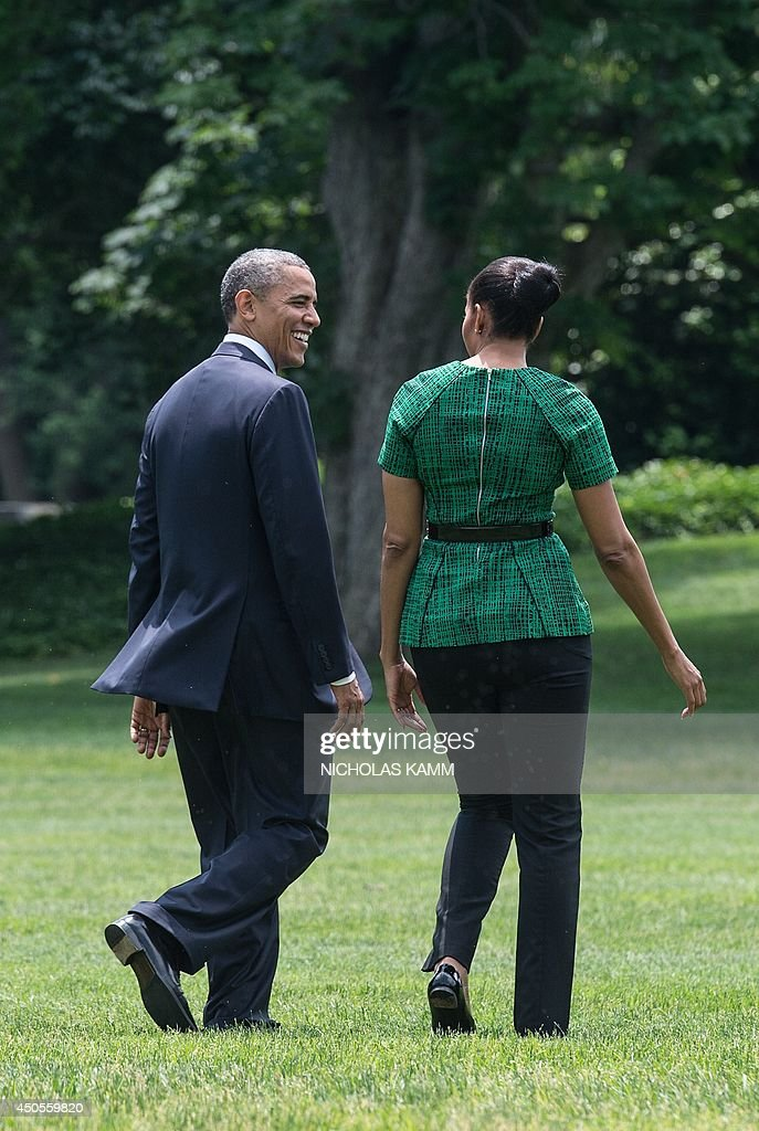 US President <a gi-track='captionPersonalityLinkClicked' href=/galleries/search?phrase=Barack+Obama&family=editorial&specificpeople=203260 ng-click='$event.stopPropagation()'>Barack Obama</a> and First Lady Michelle Obama depart the White House in Washington on June 13, 2014. The Obamas travel to the Cannon Ball, North Dakota, area to visit the Standing Rock Sioux Tribal Nation. AFP PHOTO/Nicholas KAMM