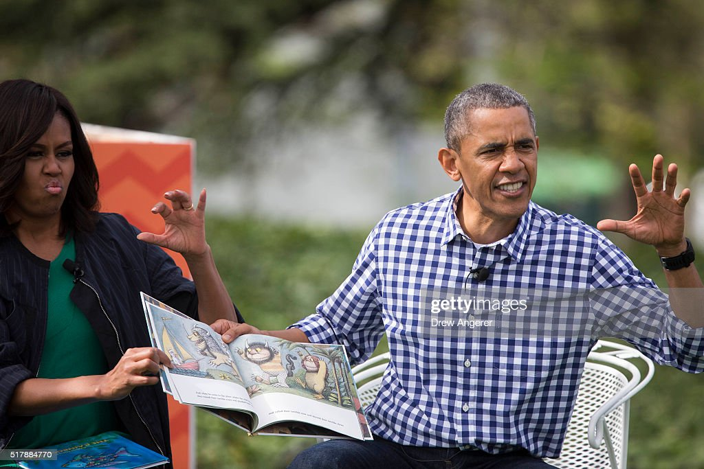 President Barack Obama and first lady Michelle Obama gesture as they read from the book 'Where the Wild Things Are' during the annual White House...