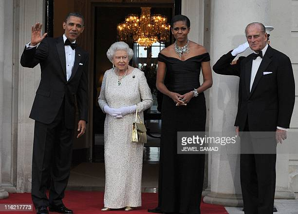 US President Barack Obama and First Lady Michelle Obama greet Britain's Queen Elizabeth II and Prince Philip the Duke of Edinburgh for a reciprocal...