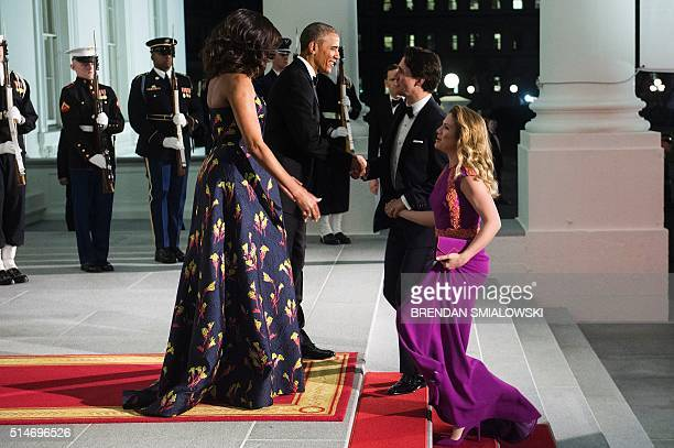 US President Barack Obama and first lady Michelle Obama greet Canadian Prime Minister Justin Trudeau and Sophie GregoireTrudeau before a state dinner...