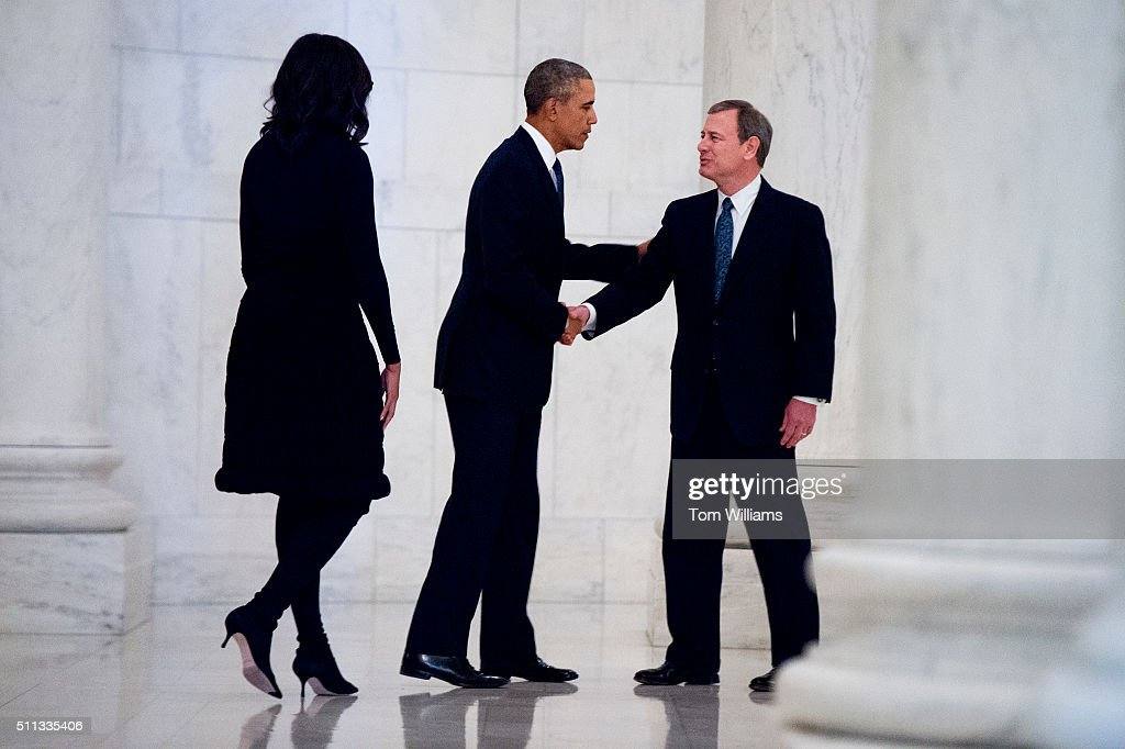President Barack Obama and First Lady Michelle Obama greet Chief Justice John Roberts right before paying respects to the late Justice Antonin Scalia...