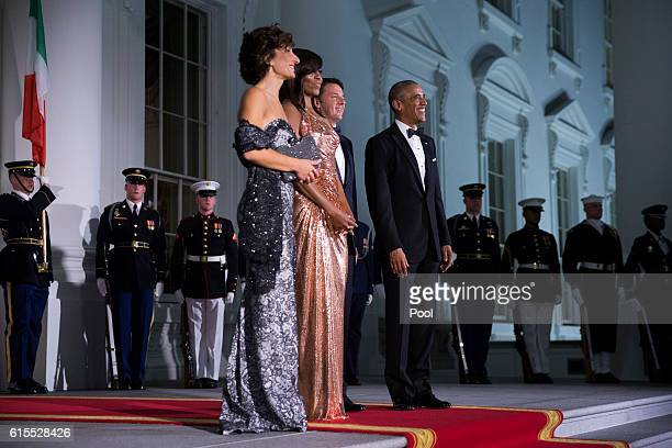 US President Barack Obama and First Lady Michelle Obama greet Italian Prime Minister Matteo Renzi and Italian First Lady Agnese Landini on the North...