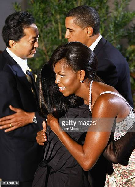 S President Barack Obama and first lady Michelle Obama greet Japanese Prime Minister Yukio Hatoyama and first lady Miyuki Hatoyama at the Phipps...