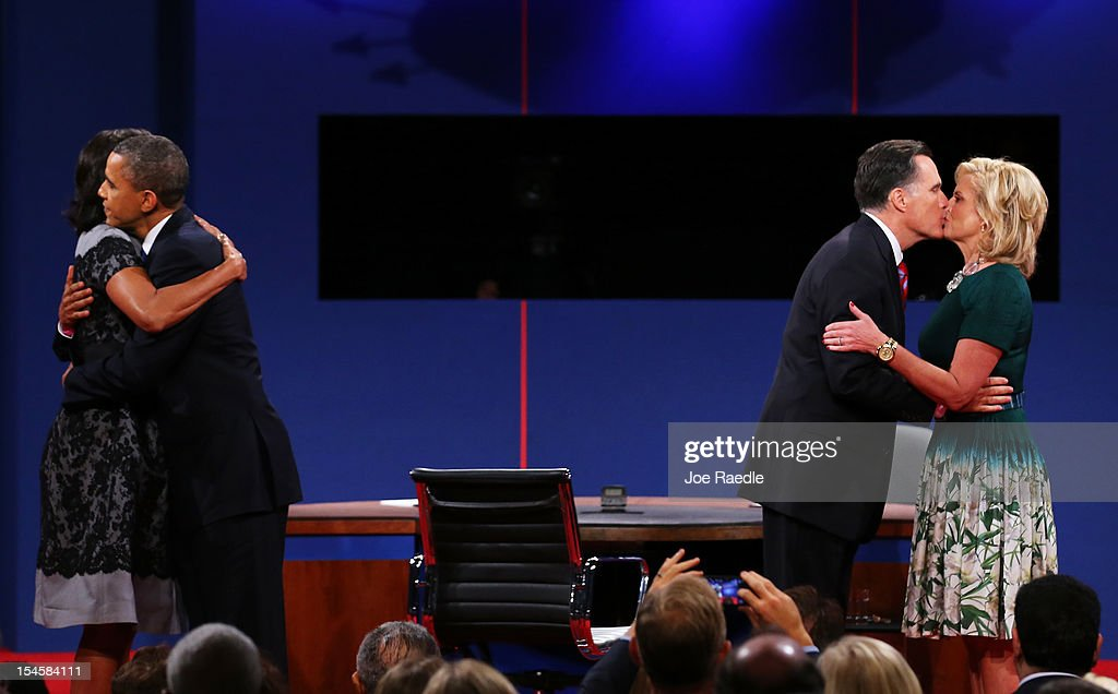 U.S. President Barack Obama (2L) and first lady Michelle Obama (L) greet on stage with Republican presidential candidate Mitt Romney and wife, Ann Romney after the debate at the Keith C. and Elaine Johnson Wold Performing Arts Center at Lynn University on October 22, 2012 in Boca Raton, Florida. The focus for the final presidential debate before Election Day on November 6 is foreign policy.