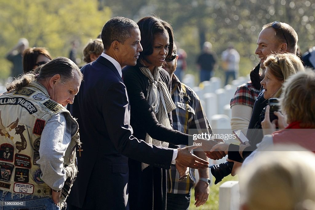 U.S. President Barack Obama and first lady Michelle Obama greet veterans and their families during a wreath-laying ceremony on Veteran's Day at the Tomb of the Unknown Soldier in Arlington National Cemetery on November 11, 2012 in Arlington, Virginia.
