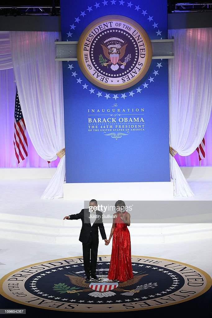 U.S. President Barack Obama (L) and first lady Michelle Obama greets attendees at the Commander-in-Chief Ball on January 21, 2013 in Washington, DC. Obama was sworn-in for his second term as president during a public ceremonial inauguration earlier in the day.