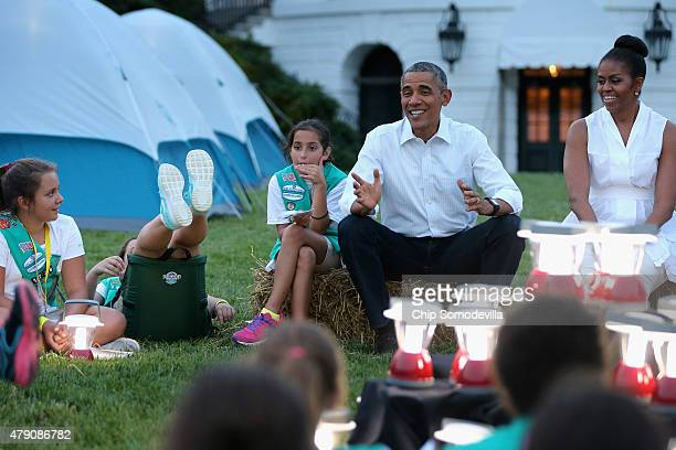 US President Barack Obama and first lady Michelle Obama host a group of Girl Scouts for a campout on the South Lawn of the White House June 30 2015...