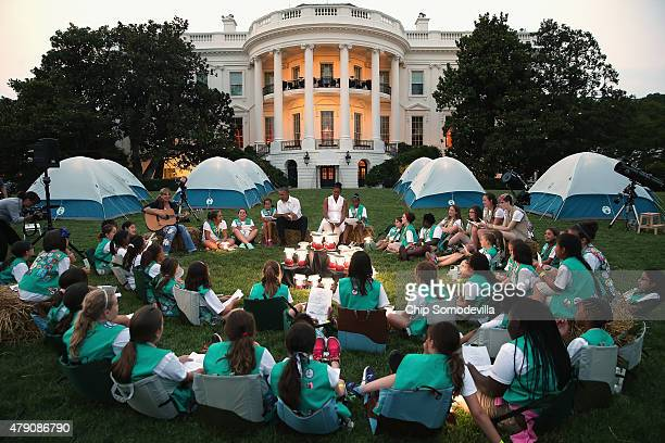 US President Barack Obama and first lady Michelle Obama host a group of Girl Scouts from across the country for a campout on the South Lawn of the...