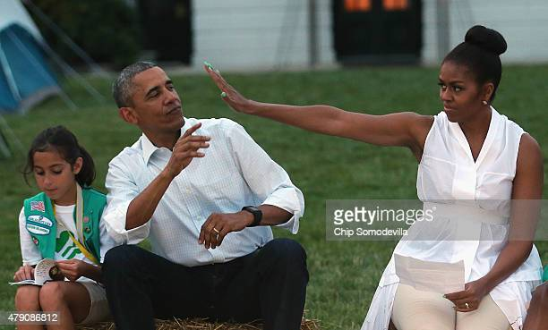 US President Barack Obama and first lady Michelle Obama host a group of Girl Scouts including Daphnye Shell of Peggs Oklahoma for a campout on the...