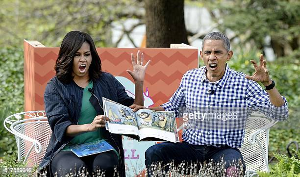 President Barack Obama and first lady Michelle Obama imitate monsters as they read 'Where the wild things are'during the White House Easter Egg Roll...
