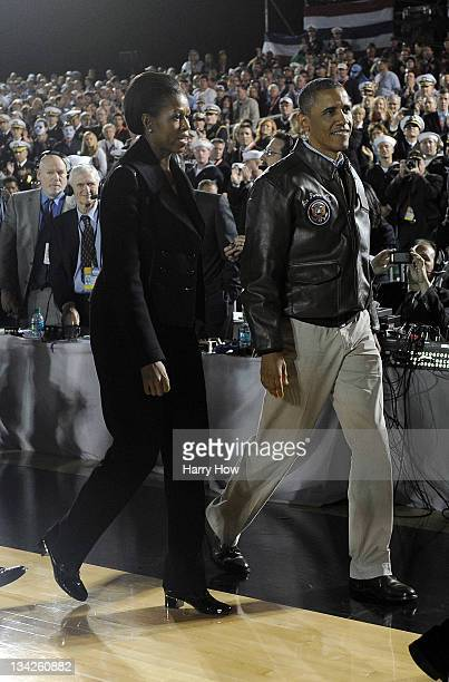 S President Barack Obama and first lady Michelle Obama leave the court after a 6755 win for the North Carolina Tar Heels over the Michigan State...