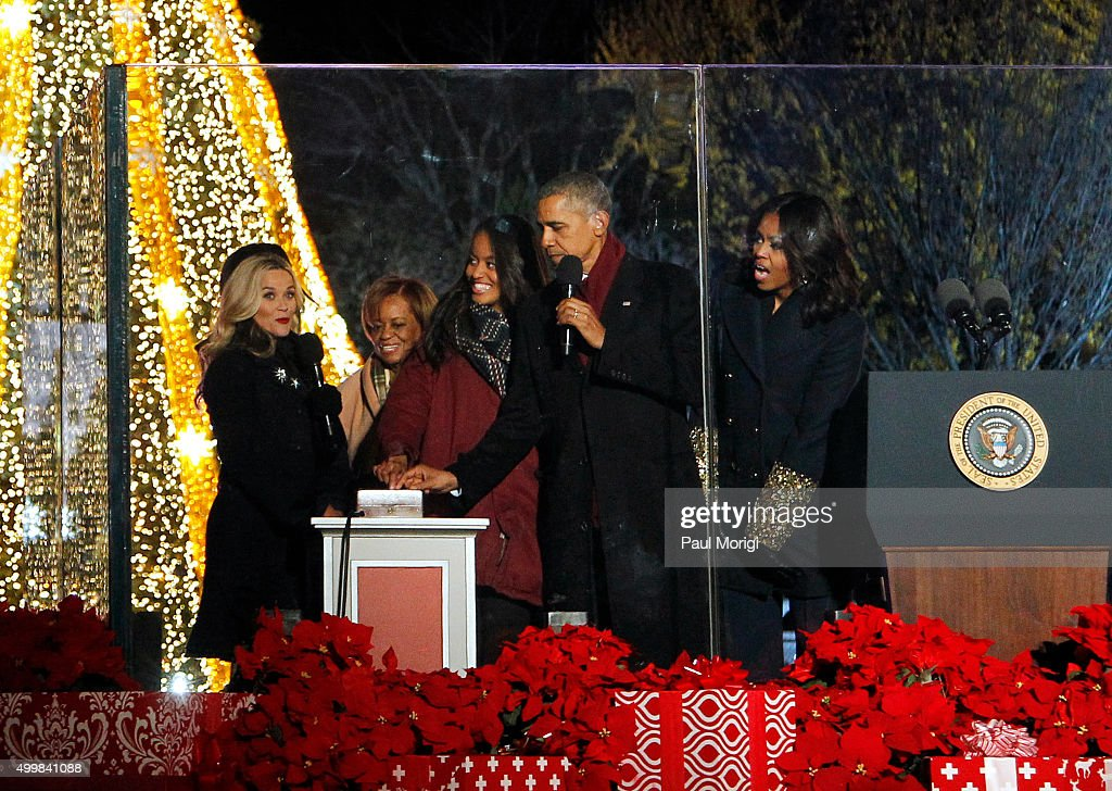 U.S. President Barack Obama (2nd R) and First Lady Michelle Obama (R) light the National Christmas Tree with Reese Witherspoon and Malia Ann Obama during the 93rd Annual National Christmas Tree Lighting at The Ellipse on December 3, 2015 in Washington, DC.