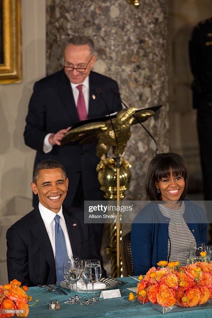 U.S. President Barack Obama and first lady Michelle Obama listen as Sen. Charles Schumer, Chairman of the Joint Congressional Committee on Inaugural Ceremonies, speaks at the Inaugural Luncheon in Statuary Hall on Inauguration day at the U.S. Capitol building January 21, 2013 in Washington D.C. President Obama was ceremonially sworn in for his second term today.
