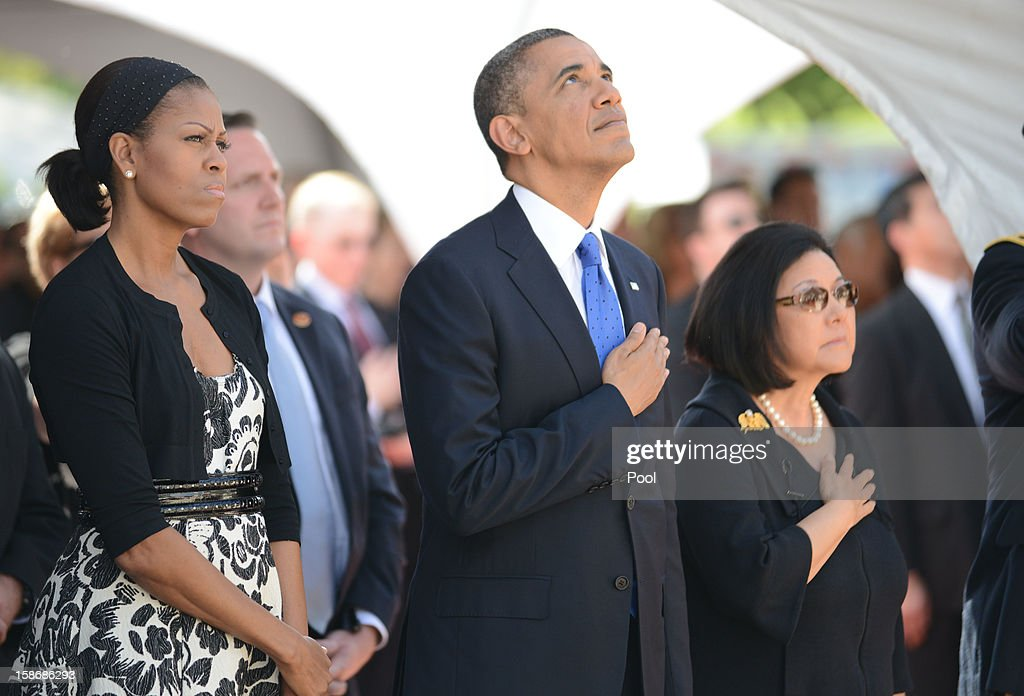 U.S. President <a gi-track='captionPersonalityLinkClicked' href=/galleries/search?phrase=Barack+Obama&family=editorial&specificpeople=203260 ng-click='$event.stopPropagation()'>Barack Obama</a> and first lady <a gi-track='captionPersonalityLinkClicked' href=/galleries/search?phrase=Michelle+Obama&family=editorial&specificpeople=2528864 ng-click='$event.stopPropagation()'>Michelle Obama</a> look up with with Senator Daniel Inouye's wife, Irene Hirano, as Hawaii Air National Guard F-22 Raptors make a flyby during the funeral services for the late Senator Daniel Inouye at the National Memorial Cemetery of the Pacific December 23, 2012 in Honolulu, Hawaii. Senator Inouye was a Medal of Honor recipient and a United States Senator since 1963.
