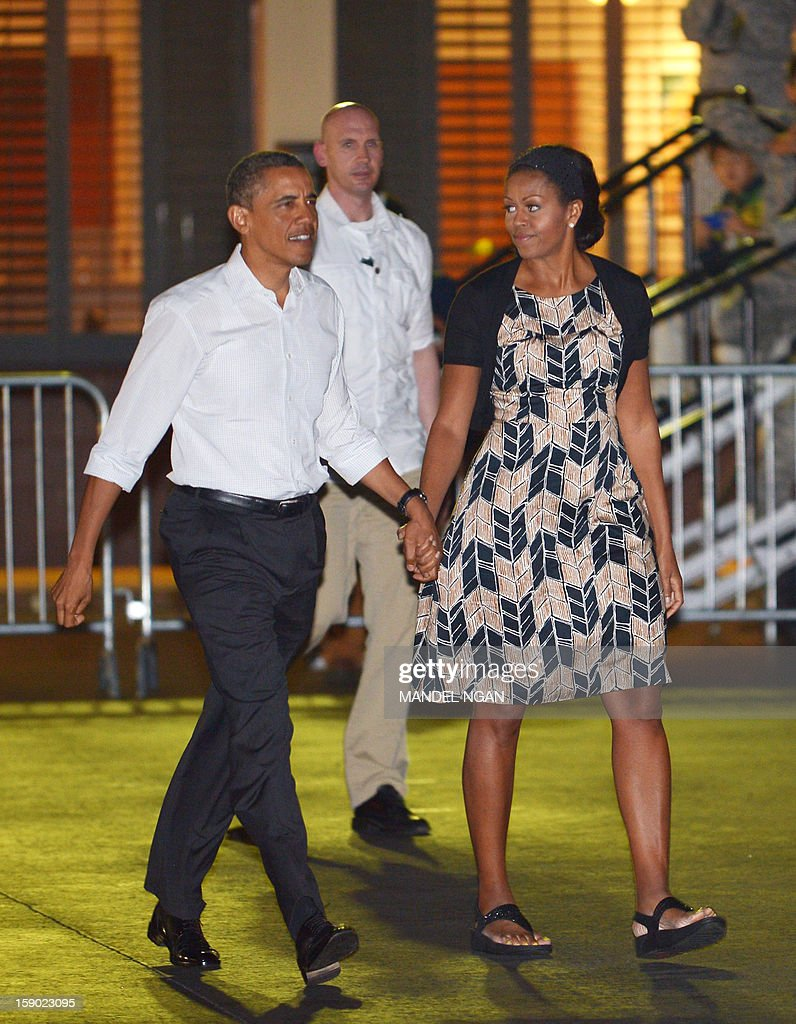 US President Barack Obama and First Lady <a gi-track='captionPersonalityLinkClicked' href=/galleries/search?phrase=Michelle+Obama&family=editorial&specificpeople=2528864 ng-click='$event.stopPropagation()'>Michelle Obama</a> make their way to board Air Force One on January 5, 2013 upon departure from Hickam Air Force Base in Honolulu, Hawaii. Obama was to return to Washington, DC after vacationing in Hawaii. AFP PHOTO / Mandel NGAN