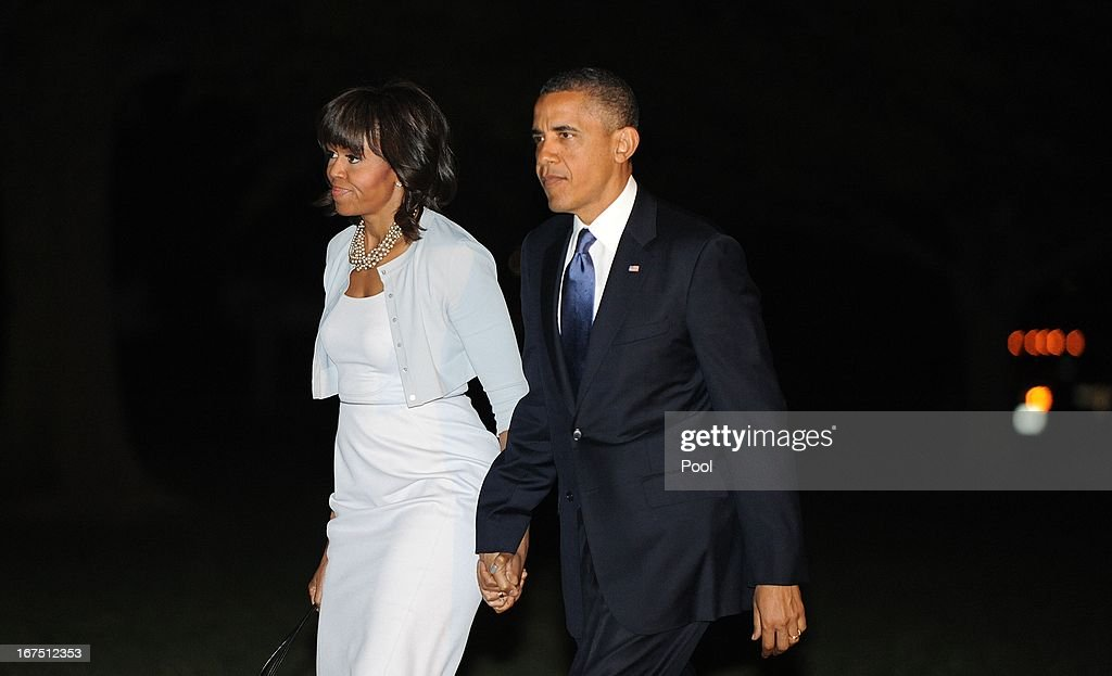U.S. President <a gi-track='captionPersonalityLinkClicked' href=/galleries/search?phrase=Barack+Obama&family=editorial&specificpeople=203260 ng-click='$event.stopPropagation()'>Barack Obama</a> and first lady <a gi-track='captionPersonalityLinkClicked' href=/galleries/search?phrase=Michelle+Obama&family=editorial&specificpeople=2528864 ng-click='$event.stopPropagation()'>Michelle Obama</a> make their way across the South Lawn upon return the White House on April 25, 2013 in Washington, DC. Obama returned from Texas after attending the George W. Bush Presidential Center dedication ceremony.