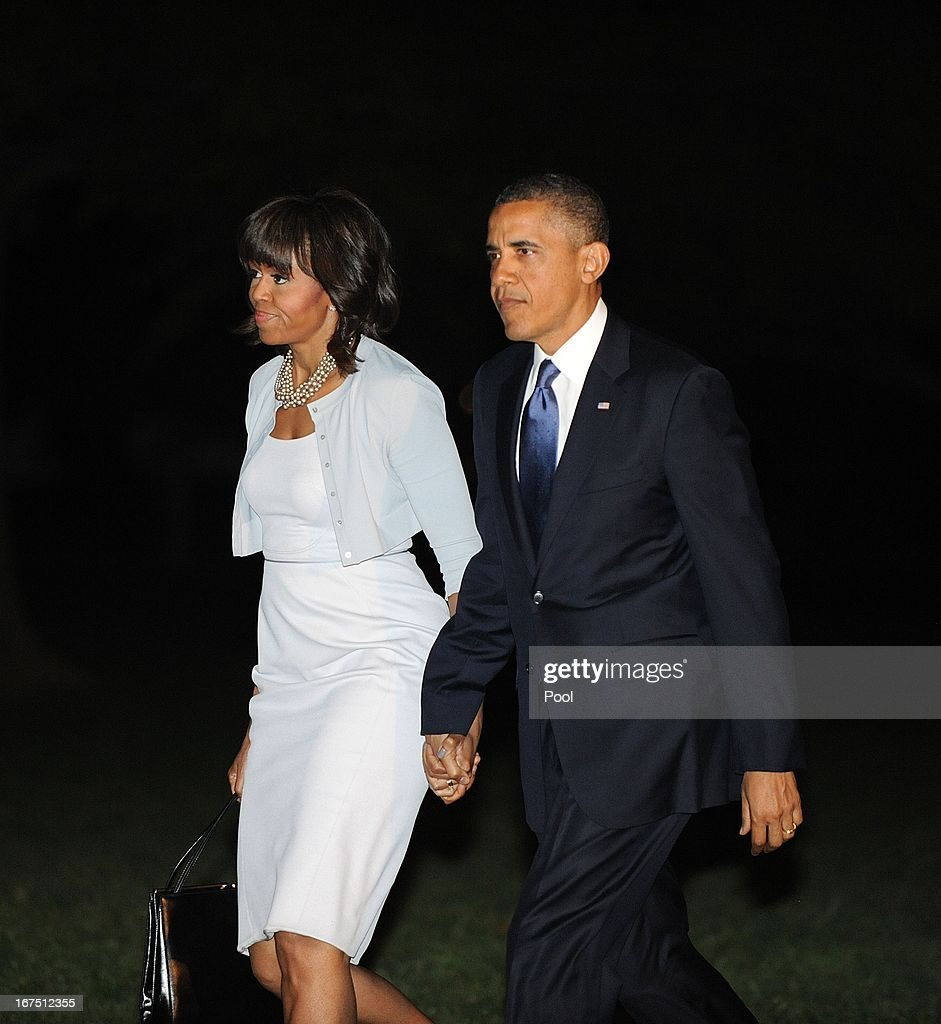U.S. President Barack Obama and first lady Michelle Obama make their way across the South Lawn upon return the White House on April 25, 2013 in Washington, DC. Obama returned from Texas after attending the George W. Bush Presidential Center dedication ceremony.