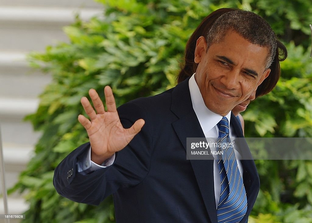 US President <a gi-track='captionPersonalityLinkClicked' href=/galleries/search?phrase=Barack+Obama&family=editorial&specificpeople=203260 ng-click='$event.stopPropagation()'>Barack Obama</a> and First Lady Michelle Obama make their way to board Marine One on the South Lawn of the White House on September 23, 2013 in Washington, DC. Obama was headed to New York City to attend the United Nations General Assembly. AFP PHOTO/Mandel NGAN