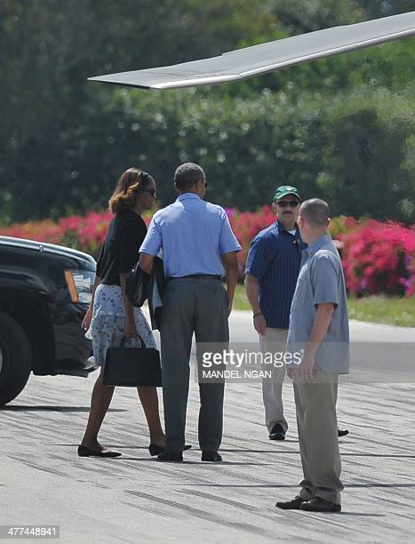 US President Barack Obama and First Lady Michelle Obama make their way to board Marine One at the Ocean Reef Club in Key Largo Florida on March 9...