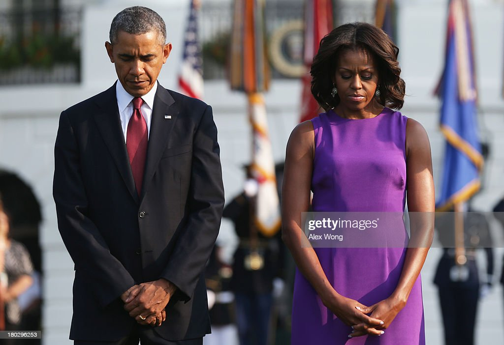 U.S. President <a gi-track='captionPersonalityLinkClicked' href=/galleries/search?phrase=Barack+Obama&family=editorial&specificpeople=203260 ng-click='$event.stopPropagation()'>Barack Obama</a> and first lady <a gi-track='captionPersonalityLinkClicked' href=/galleries/search?phrase=Michelle+Obama&family=editorial&specificpeople=2528864 ng-click='$event.stopPropagation()'>Michelle Obama</a> observe a moment of silence to mark the 12th anniversary of the 9/11 attacks September 11, 2013 at the South Lawn of the White House in Washington, DC. The nation is commemorating the anniversary of the 2001 attacks which resulted in the deaths of nearly 3,000 people after two hijacked planes crashed into the World Trade Center, one into the Pentagon in Arlington, Virginia and one crash landed in Shanksville, Pennsylvania.