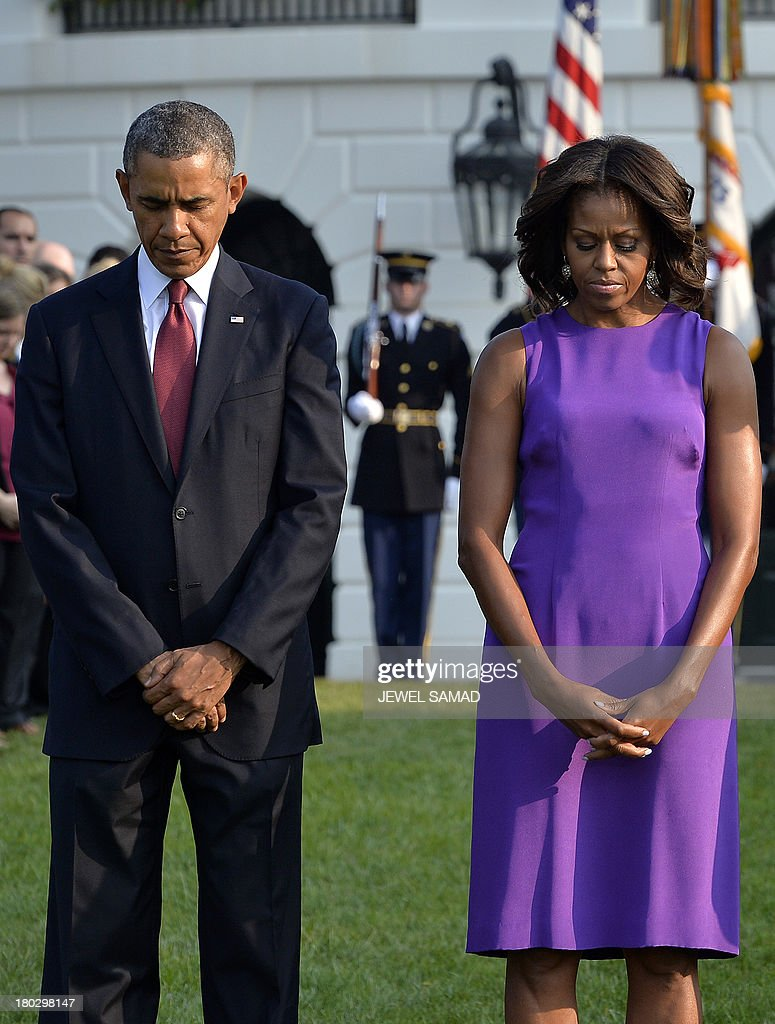 US President <a gi-track='captionPersonalityLinkClicked' href=/galleries/search?phrase=Barack+Obama&family=editorial&specificpeople=203260 ng-click='$event.stopPropagation()'>Barack Obama</a> and First Lady Michelle Obama observe a moment of silence to mark the 12th anniversary of the 9/11 attacks on the South Lawn of the White House in Washington, DC, on September 11, 2013. AFP PHOTO/Jewel Samad