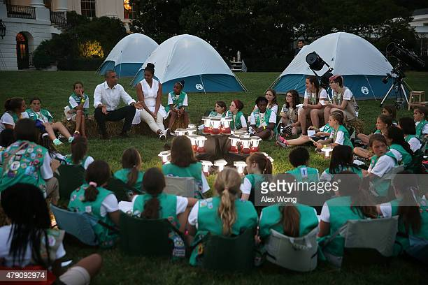 S President Barack Obama and first lady Michelle Obama particiapte in campfire songs session with fourthgrade Girl Scouts during the firstever White...