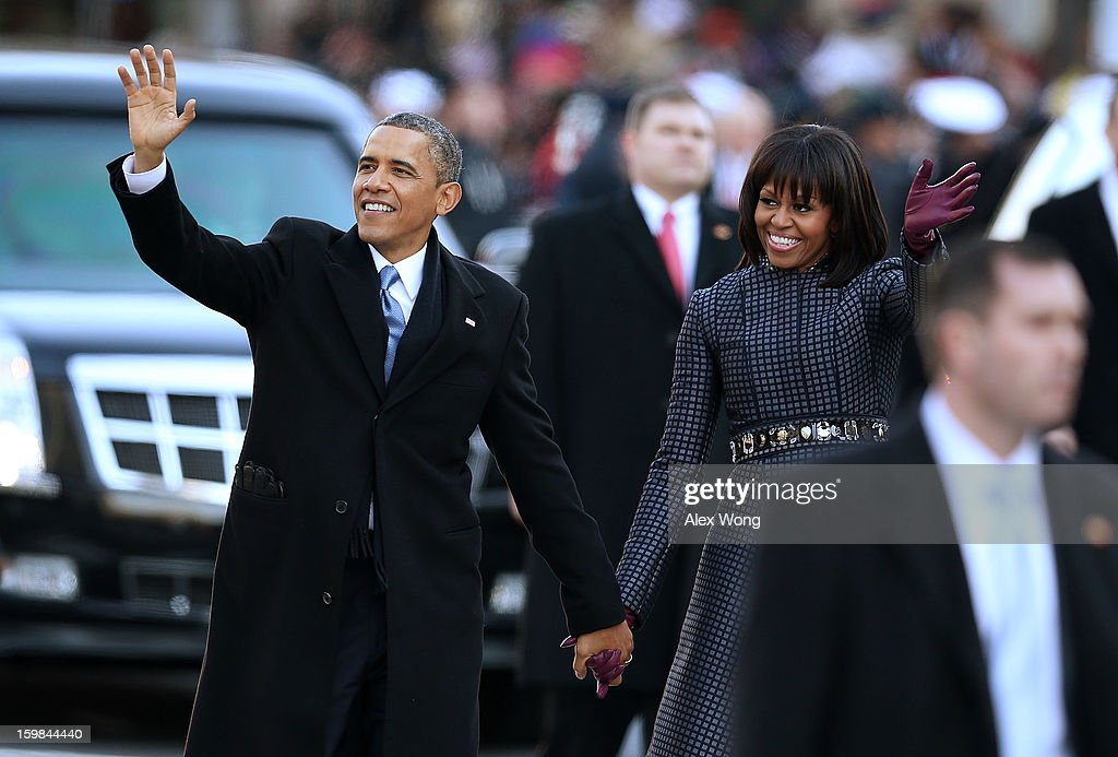 U.S. President Barack Obama and first lady Michelle Obama participate during the inaugural parade on Pennsylvania Avenue January 21, 2013 in Washington, DC. Barack Obama was re-elected for a second term as President of the United States.