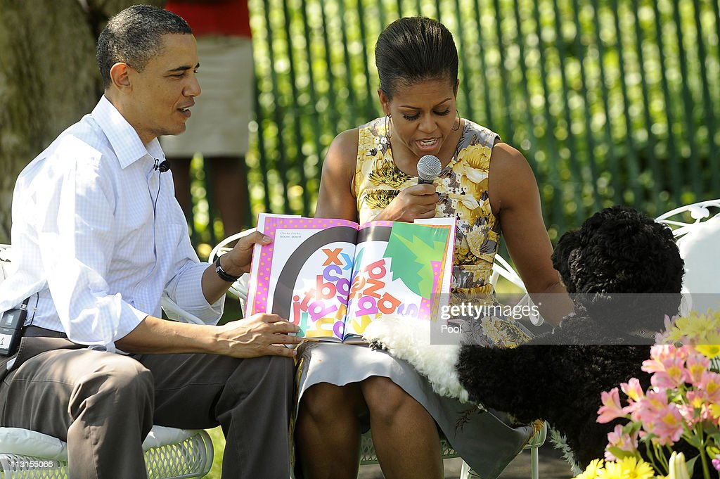 US President Barack Obama and first lady Michelle Obama read 'Chicka Chicka Boom Boom' to children as their dog Bo tries to get attention during the...