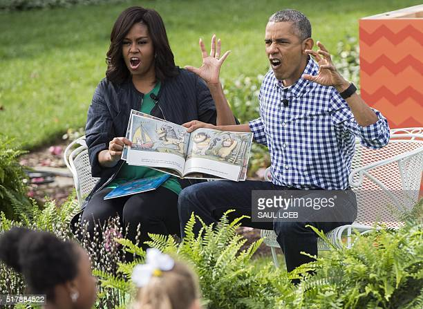 US President Barack Obama and First Lady Michelle Obama read the book 'Where the Wild Things Are' during the annual Easter Egg Roll on the South Lawn...