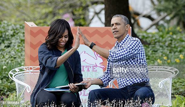 President Barack Obama and first lady Michelle Obama read 'Where the wild things are'during the White House Easter Egg Roll on the South Lawn of the...