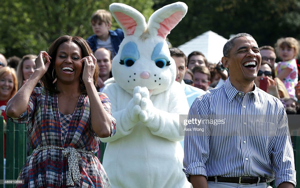 S President Barack Obama and first lady Michelle Obama rejoice as they watch children participate in the annual White House Easter Egg Roll on the...
