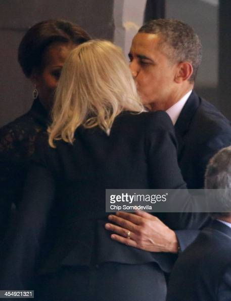 S President Barack Obama and first lady Michelle Obama say goodbye to Denmark's Prime Minister Helle Thorning Schmidt before leaving the official...