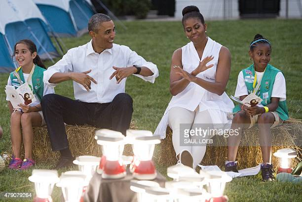 US President Barack Obama and First Lady Michelle Obama show off their dance moves as they visit with Girl Scouts that are camping overnight on the...
