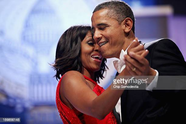 S President Barack Obama and first lady Michelle Obama sing together as they dance during the Inaugural Ball at the Walter Washington Convention...